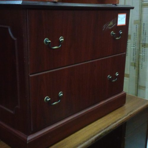 Used HON 94223 2-drawer lateral file featuring picture frame side molding and mahogany finish.