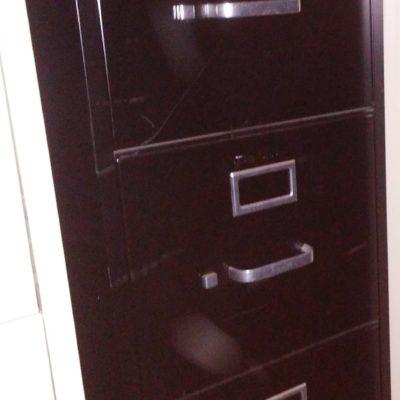 Used black 4-drawer letter file
