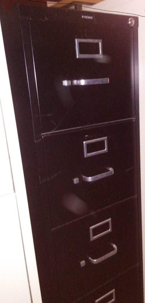 Used black 4-drawer letter file