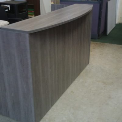"""6' Reception desk with 12"""" deep bow front transaction counter and box/file pedestal Gray laminate"""