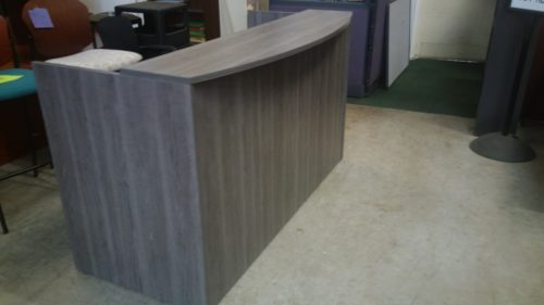 "6' Reception desk with 12"" deep bow front transaction counter and box/file pedestal Gray laminate"