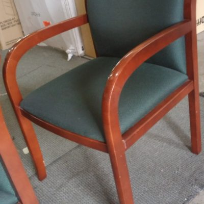 Used cherry wood guest chair with green fabric